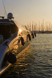 Luxury yacht at sunset. A view of the side of a luxury motor yacht at sunset in a greek marina Royalty Free Stock Images