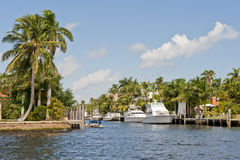 Luxury yacht on tropical canal Royalty Free Stock Photos