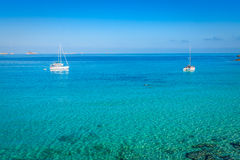 Luxury yacht in turquoise Illetes Formentera mediterranean sea B Royalty Free Stock Photography