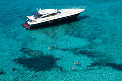 Luxury yacht in turquoise Illetes Formentera mediterranean sea B Stock Photos
