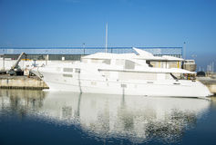 Luxury yacht under construction moored at the port Stock Photo
