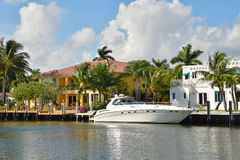 Luxury yacht and waterfront home Stock Image