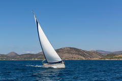 Luxury yacht with white sails in the Aegean sea Royalty Free Stock Photos