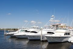 Luxury Yachts. Expensive luxury yachts remain docked at the pier in Pensacola, Florida stock photos