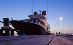 Luxury yachts in Anapa harbor at night with reflection in water. Royalty Free Stock Photo