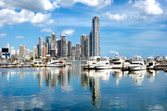 Luxury yachts. On the background of skyscrapers with water reflection - Panama City Royalty Free Stock Image