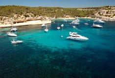 Luxury yachts at the bay. Luxury yachts anchoring at wonderfull bay royalty free stock photos