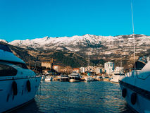 Luxury yachts on the coast in winter season. Royalty Free Stock Image