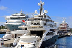 Luxury Yachts and Cruise Ship. These beautiful vessels are all gathered in the St. Thomas Harbour and marina. Perfect climate for a cruise large or larger stock photography