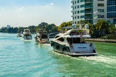 Luxury yachts cruising Stock Image