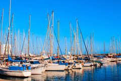 Yachts and pier at dusk. Luxury yachts docked in sea port at col royalty free stock photos
