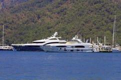 Luxury Yachts at Gocek Marina. Two luxury yachts at Gocek marina near the mountains  in Fethiye Turkey Royalty Free Stock Image
