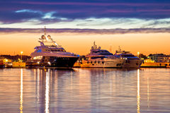 Luxury yachts harbor at golden hour view royalty free stock photo