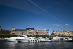 Luxury yachts at marina. Luxury yachts docked at a marina on a river in the center of Stockholm, Sweden royalty free stock photo