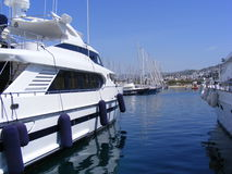 Luxury Yachts in Marina. Private luxury yachts line the marina in Turgutreis, near Bodrum in Southwest Turkey Royalty Free Stock Photos