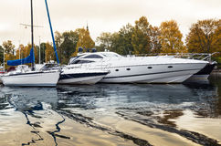Luxury yachts at marina. Luxury yachts docked at a marina on a river in the center of Stockholm, Sweden Stock Photo