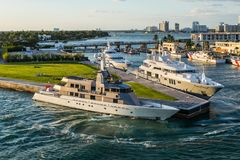 Luxury Yachts at Miami Marina, Florida, USA. Miami, FL, United States - April 20, 2019:  Luxury yachts docked in the port of Miami, Florida, United States of royalty free stock photography