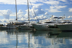 Luxury yachts moored on pier Stock Images