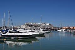 Marina Vilamoura , Algarve, Portugal, Europe. Luxury Yachts and motor boats moored at the marina of Vilamoura with blue sky in background. Horizontal view royalty free stock photo