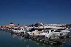 Marina Vilamoura , Algarve, Portugal, Europe. Luxury Yachts and motor boats moored at the marina of Vilamoura with blue sky in background. Horizontal view stock image