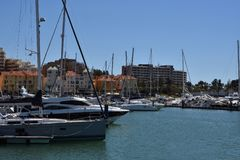 Marina Vilamoura , Algarve, Portugal, Europe. Luxury Yachts and motor boats moored at the marina of Vilamoura with blue sky and buildings in background stock images