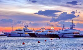 Luxury yachts in Mykonos, Greece. Luxury yachts in a marina in Mykonos Greece at the sunset royalty free stock image