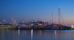 Luxury yachts. Night shot of Luxury yachts standing side by side at greece Royalty Free Stock Photography