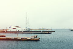 Luxury yachts parked in a bay on the sea. Background horizontal image stock image