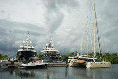 Luxury yachts in port in Colon Panama. June 9, 2016 Shelter Bay, Panama: luxury superyacths docked in the private marina by the Panama Channel stock photos