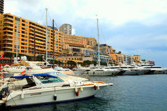 Luxury yachts in the port Hercules and cityview in Monte Carlo, royalty free stock image