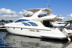 Luxury yachts in the port. Luxury motor yacht on the dock Stock Image