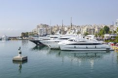 Luxury yachts in the port of Piraeus. On a sunny summer day stock photo