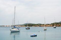 Luxury yachts in Puerto Portals marina. PUERTO PORTALS, MALLORCA, SPAIN - APRIL 24, 2018: Luxury yachts moored in the marina of Puerto Portals on an overcast day Stock Photo
