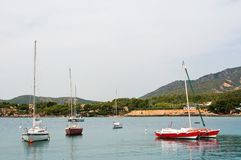 Luxury yachts in Puerto Portals marina. PUERTO PORTALS, MALLORCA, SPAIN - APRIL 24, 2018: Luxury yachts moored in the marina of Puerto Portals on an overcast day Royalty Free Stock Photo