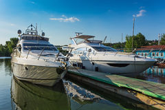 Luxury yachts in quiet haven Stock Photography