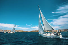 Luxury yachts at regatta.  Sailling. Luxury yachts at regatta. Sailing through the waves at the Aegean Sea Royalty Free Stock Images