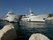 Luxury yachts at sea. Two white large luxury yachts anchored in the Adriatic sea - Mediterranean - Croatia - Split. Horizontal color photo Stock Image