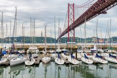 Lisbon skyline. Luxury yachts in seaport near the 25 April bridge in Lisbon, Portugal stock photos