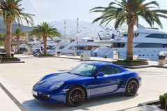 Luxury yachts and sports car