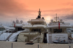 Luxury yachts at sunset Stock Photos