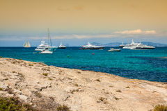 Luxury yachts in turquoise beach of Formentera Illetes Stock Photo