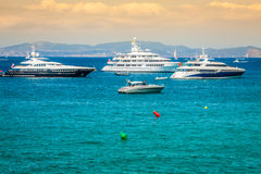 Luxury yachts in turquoise beach of Formentera Illetes Stock Photos