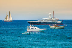 Luxury yachts in turquoise beach of Formentera Illetes Royalty Free Stock Photo