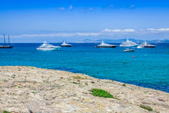 Luxury yachts in turquoise beach of Formentera Illetes Royalty Free Stock Image