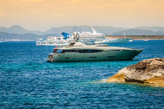Luxury yachts in turquoise beach of Formentera Illetes Stock Photography