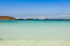 Luxury yachts in turquoise beach of Formentera Illetes Royalty Free Stock Photography
