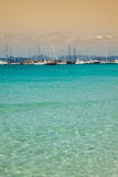 Luxury yachts in turquoise beach of Formentera Illetes Stock Images