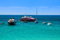 Luxury yachts in turquoise beach of Formentera Illetes Royalty Free Stock Images