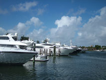 Luxury Yachts at Urban Marina. View of a row of luxury yachts at a private urban marina, harbor Stock Image