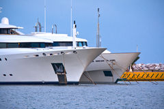 Luxury yachts. View of a luxury yachts bows at a marina Stock Photography
